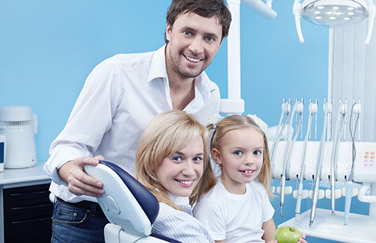 A happy family at a dental